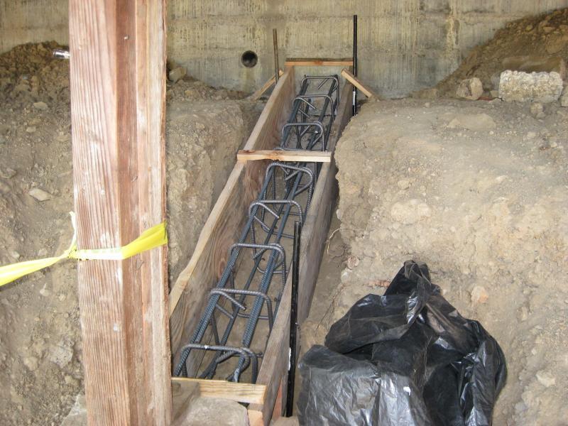 Poured new grade beams for earthquake retrofit.